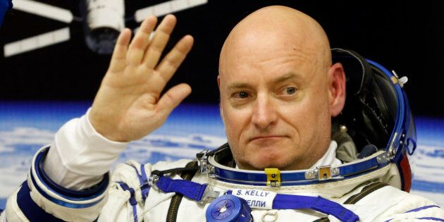 U.S. astronaut Scott Kelly, crew member of the mission to the International Space Station, ISS, gestures...