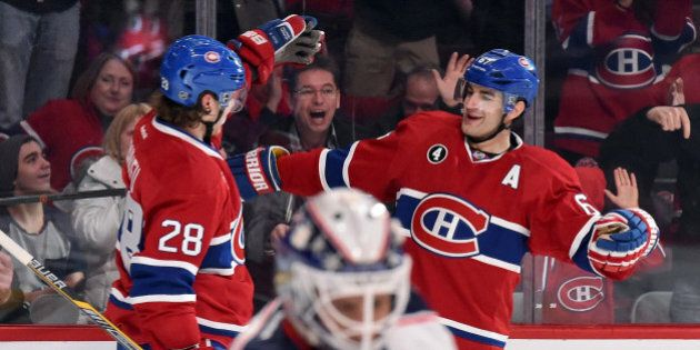 MONTREAL, QC - FEBRUARY 21: Max Pacioretty #67 of the Montreal Canadiens celebrate with teammate Nathan Beaulieu #28  after scoring a second goal against the Columbus Blue Jackets in the NHL game at the Bell Centre on February 21, 2015 in Montreal, Quebec, Canada. (Photo by Francois Lacasse/NHLI via Getty Images)