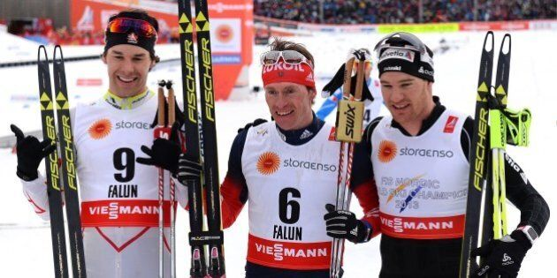 Winner Maxim Vylegzhanin of Russia (C), third placed Alex Harvey of Canada (L) and second placed Dario Cologna of Switzerland react after the men cross-country skiathlon15 km classic and 15 km free race during the 2015 FIS Nordic World Ski Championships in Falun, Sweden, on February 21, 2015.    AFP PHOTO / JONATHAN NACKSTRAND        (Photo credit should read JONATHAN NACKSTRAND/AFP/Getty Images)