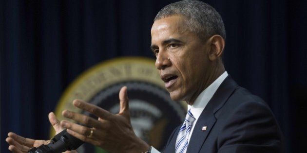 US President Barack Obama delivers remarks on countering violent extremism in Washington, DC, February...