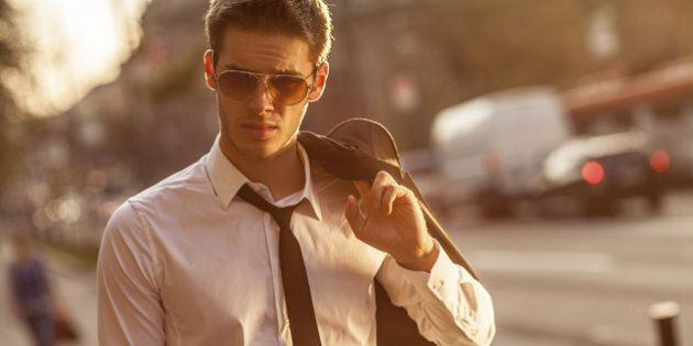 handsome businessman walking back home from work