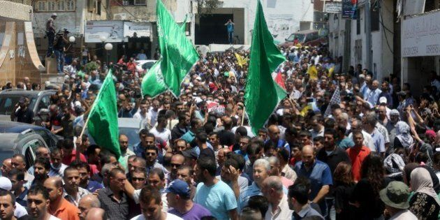 RAMALLAH, WEST BANK - AUGUST 01: Palestinians carry the body of 21-years-old Laith al-Khalidi, shot dead...