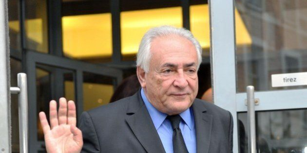 Former IMF chief Dominique Strauss-Kahn leaves his hotel on February 16, 2015, in the northern French...