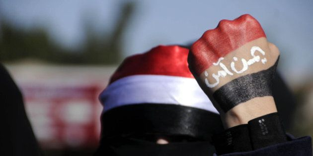 SANAA, YEMEN - JANUARY 24: Yemeni protestors gather at Change Square shout slogans during a rally against...