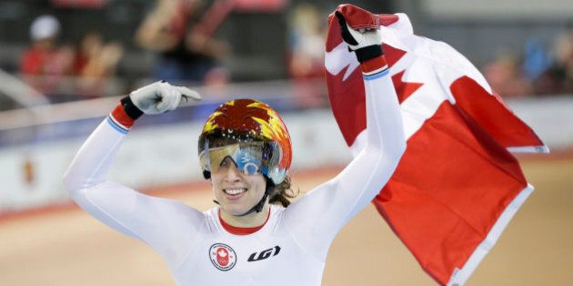 Canada's Monique Sullivan celebrates after winning the women's keirin track cycling competition at the Pan Am Games in Milton, Ontario, Friday, July 17, 2015. Sullivan won the gold medal. (AP Photo/Felipe Dana)