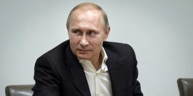 Russian President Vladimir Putin speaks during a meeting at the