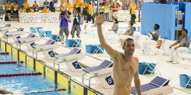 Gold medalist Ryan Cochrane of Canada waves to the crowd after competing in the Men's 15000M Freestyle finals at the 2015 Pan American Games in Toronto, Canada, July 18, 2015.     AFP PHOTO/ JIM WATSON        (Photo credit should read JIM WATSON/AFP/Getty Images)
