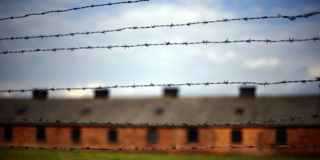Barbed wire fences surround barracks of the former Auschwitz-Birkenau Nazi death camp in Oswiecim, Poland,...
