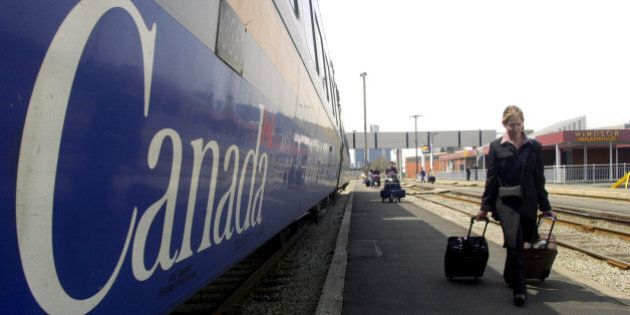 Passengers make their way to a VIA Rail Canada train leaving the station in Windsor, Ontario, Thursday,...