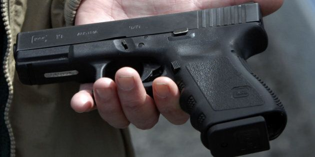 Roanoke Firearms owner John Markell holds a Glock 9 mm pistol in Roanoke, Va., Tuesday, April 17, 2007....