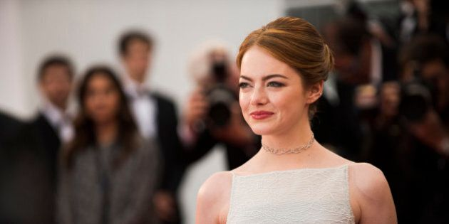 Actress Emma Stone poses for photographers on the red carpet at the screening of the film Irrational...