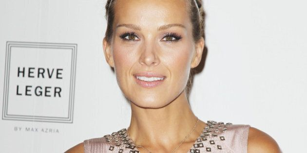 In this image released by Starpix, Petra Nemcova poses at the Herve Leger by Max Azria Spring 2015 show during Fashion Week, Saturday, Sept. 6, 2014, in New York. (AP Photo/Starpix, Amanda Schwab)