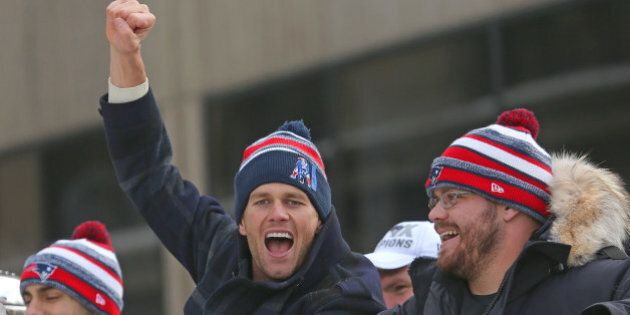 BOSTON - FEBRUARY 4: Patriots quarterback Tom Brady cheers as the Super Bowl victory parade continues...