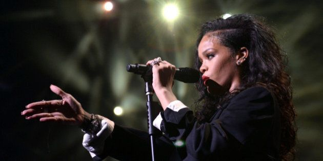 GLENDALE, AZ - JANUARY 31: Singer Rihanna performs onstage during DirecTV Super Saturday Night hosted...