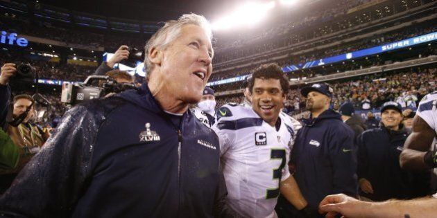 Seattle Seahawks head coach Pete Carroll and quarterback Russell Wilson celebrate after a 43-8 victory...