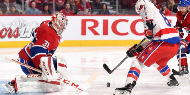 MONTREAL, QC - JANUARY 31: Carey Price #31 of the Montreal Canadiens makes a save off the shot by Jay...