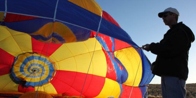This May 26, 2011 image shows balloonist Troy Bradley inflating his son Bobby's new ultra-light hot air...