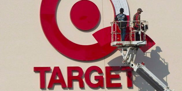 Workers install an outdoor sign at the new Target store at the Mic Mac Mall in Dartmouth, N.S. on July...