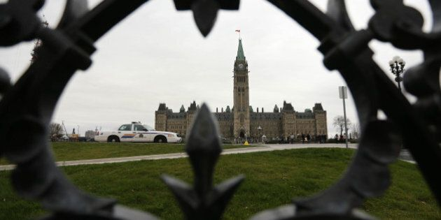 OTTAWA, ON - NOVEMBER 10:RCMP cars sit on Parliament Hill. Preparations are under way War Memorial on...