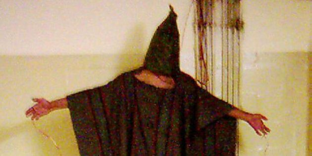 **FILE** This is an image obtained by The Associated Press which shows an unidentified detainee standing...