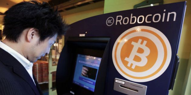 Customer Kiyono Yuichi purchases bitcoins from the BMEX bitcoin exchange's Robocoin-branded automated...