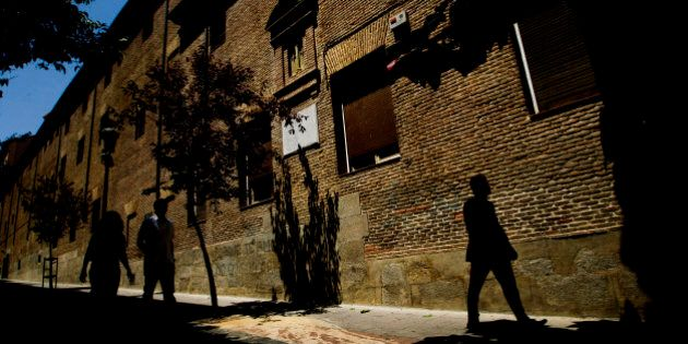 People walk by the closed order convent of the Trinitarias Descalzas nuns, where the Spanish writer Miguel...