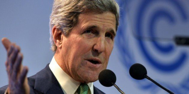 US Secretary of State John Kerry delivers a speech in Lima on December 11, 2014, during the UN 20th session...