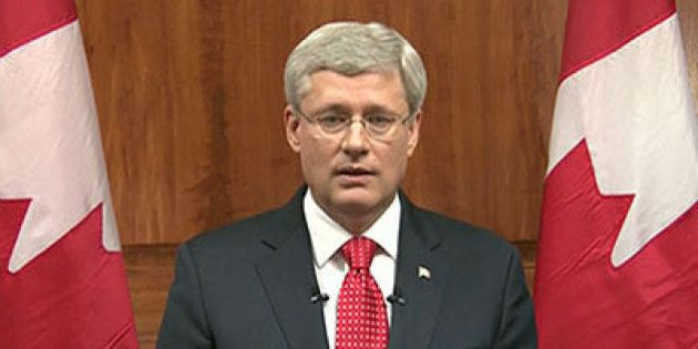 In this frame grab taken from video, Canada Prime Minister Stephen Harper speaks during a televised address...