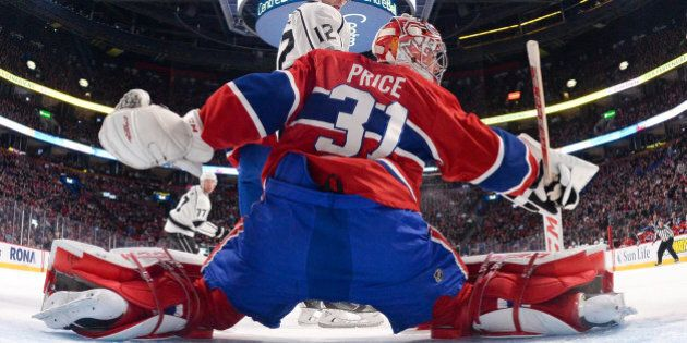 MONTREAL, QC - DECEMBER 12: Carey Price #31 of the Montreal Canadiens makes a blocker save against Marian...