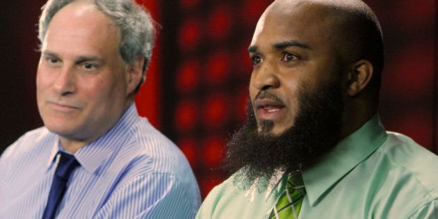 In this photo taken Feb. 14, 2011, plaintiff Abdullah al-Kidd, right, and his attorney, American Civil...