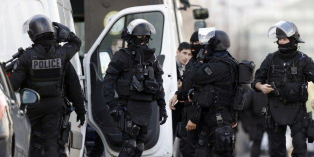 French Research and Intervention Brigades (BRI) policemen officers prepare near the post office where...