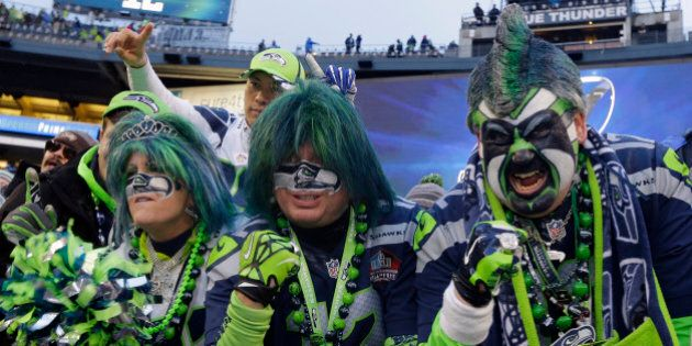 Seattle Seahawks fans celebrate after overtime of the NFL football NFC Championship game against the...