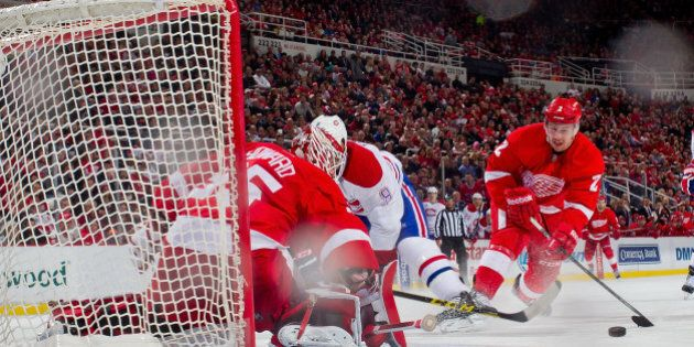 DETROIT, MI - FEBRUARY 16: Goalie Jimmy Howard #35 of the Detroit Red Wings makes a save on Brandon Prust...