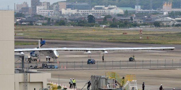 The Solar Impulse 2 solar-powered airplane is seen parked on the apron at the Nagoya airport on June...
