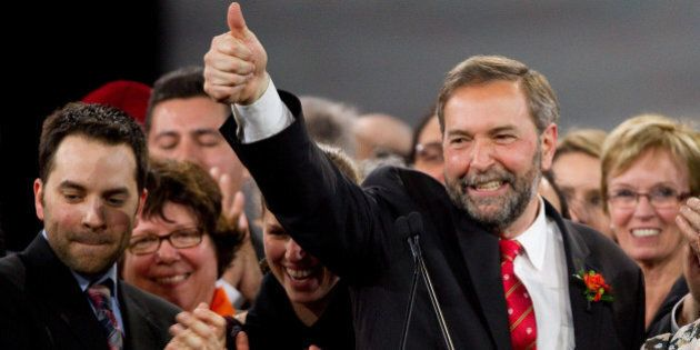 Thomas Mulcair celebrates his win at the NDP leadership convention in Toronto, Ontario, March 24, 2012.  Canada's social democrats Saturday chose a firebrand center-leaning MP to run for prime minister in 2015, after the death of a leader who led them to into the opposition benches in a historic ballot last year.  Former deputy leader Thomas Mulcair won the New Democratic Party nomination with 33,881 votes, beating out six rivals by vowing to track the NDP to the center to appeal to a broader electorate and consolidate its recent gains.   AFP PHOTO / Geoff Robins (Photo credit should read GEOFF ROBINS/AFP/Getty Images)