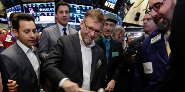Shopify CFO Russ Jones, center, rings a ceremonial bell as the Canadian company's IPO begins trading,...
