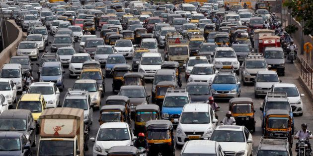 Traffic clogs a road in Mumbai, India, Thursday, April 9, 2015. Air pollution kills millions of people...