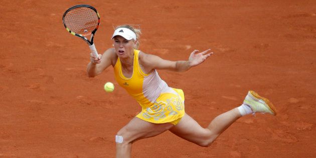 Denmark's Caroline Wozniacki returns the ball to Germany's Julia Goerges during their second round match...