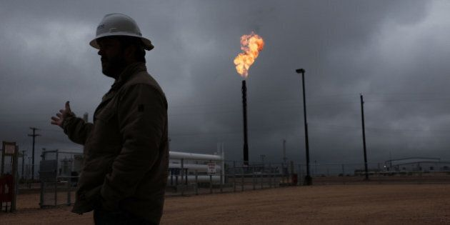 GARDEN CITY, TX - FEBRUARY 05: An oil well owned an operated by Apache Corporation in the Permian Basin...