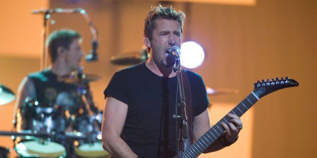 Singer Chad Kroeger and drummer Daniel Adair of Nickelback perform at the Juno Awards on Sunday, April...