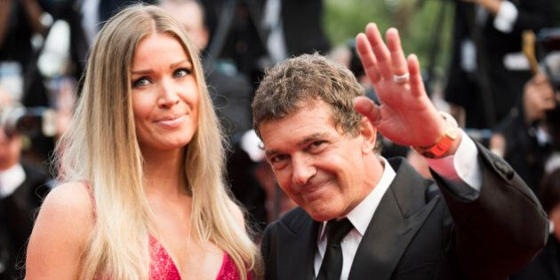 Nicole Kempel and Antonio Banderas pose for photographers as she arrives for the screening of the film Sicario at the 68th international film festival, Cannes, southern France, Tuesday, May 19, 2015. (Photo by Arthur Mola/Invision/AP)
