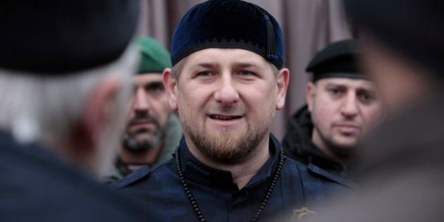 Chechnya's regional leader Ramzan Kadyrov, center, speaks to Chechen top commanders while inspecting Chechen special forces in Grozny, Russia, Sunday, Dec. 28, 2014. About 20,000 armed security forces attend a rally at a stadium in Chechen capital Grozny. Kadyrov said that Chechens could serve as
