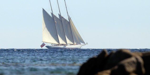 The yacht Adix, owned by Spanish Santander banking group and flying a British flag, sails off Testa beach...