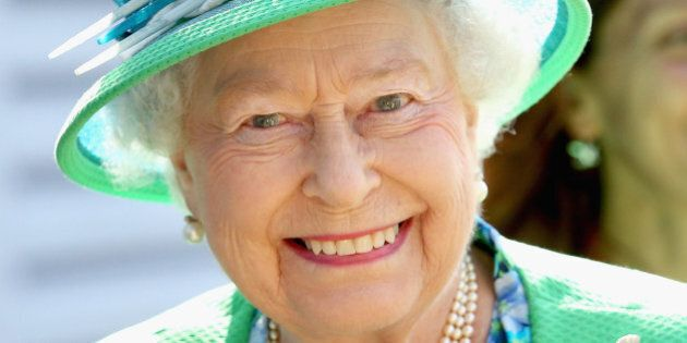 GLASGOW, SCOTLAND - JULY 24: Queen Elizabeth II smiles as she visits the Glasgow National Hockey Centre...