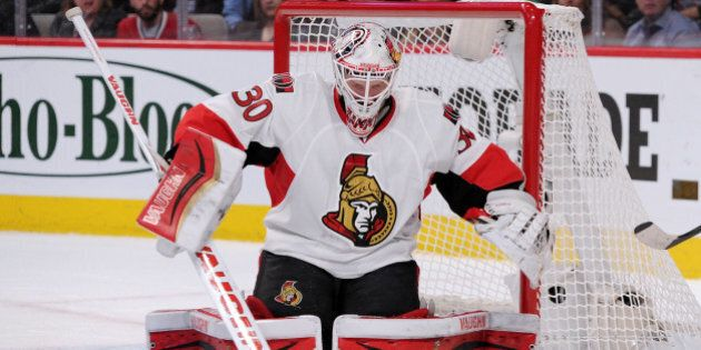 MONTREAL, QC - APRIL 15: Andrew Hammond #30 of the Ottawa Senators stops the puck during Game One of...
