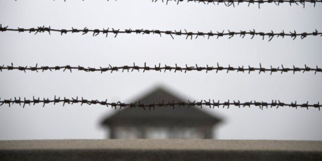 TO GO WITH AFP STORY BY NINA LAMPARSKIA barbed wire fence is pictured at the former Nazi concentration...