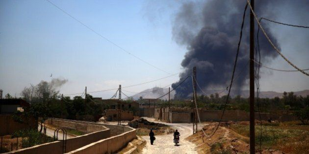 A general view shows heavy smoke rising after rebel fighters reportedly fired mortar shells targeting...