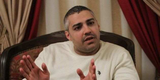 Al-Jazeera journalist Mohamed Fahmy gives an interview in Cairo on February 14, 2015 after he and his...