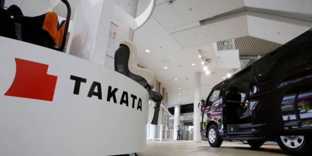 Child seats, manufactured by Takata Corp. are displayed at a Toyota Motor Corp.'s showroom in Tokyo Thursday,...