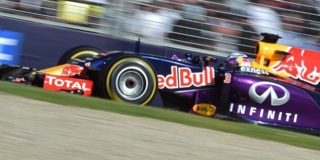 Infiniti Red Bull Racing's Australian driver Daniel Ricciardo races past the crowd during the Formula...